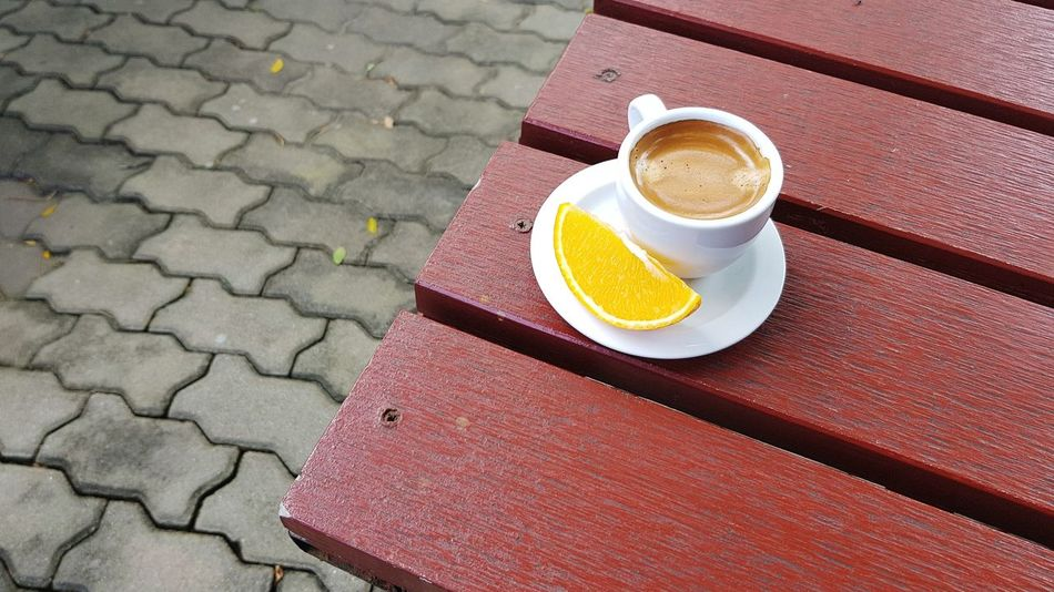Espresso cup with piece of Orange on red wooden table at outdoor space Concrete Floor Block Pattern Slice Of Orange SLICE Piece Caffeine Coffee Hot Coffee Shot Outdoor Space Wood Log EyeEm Selects Drink Frothy Drink Cappuccino Cafe Table Coffee - Drink High Angle View Coffee Cup Close-up Food And Drink Espresso Black Coffee Caffeine Coffee Beverage