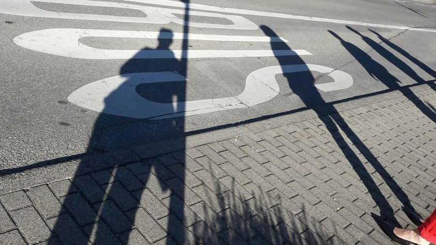 Shadow Of People On Road