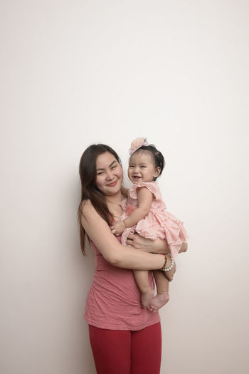 mother daughter bonding. happy mother's day Mothers Day Eyeem Philippines The Week on EyeEm Friendship Child Portrait Togetherness Smiling Young Women Bonding Happiness Girls Studio Shot Arm In Arm Single Parent Family Bonds Human Connection
