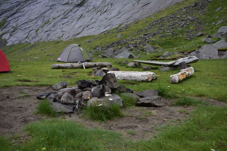 Rocks on field against mountain