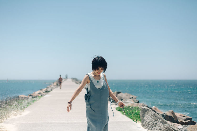 Sea Water Sky Beach Casual Clothing Land Standing Real People Leisure Activity One Person Day Lifestyles Nature Horizon Over Water Three Quarter Length Clear Sky Horizon Beauty In Nature Outdoors Travel Destinations People Portrait The Traveler - 2019 EyeEm Awards