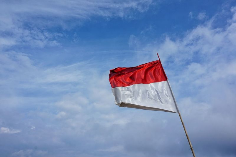 Indonesia flag fluttering in the clear blue sky