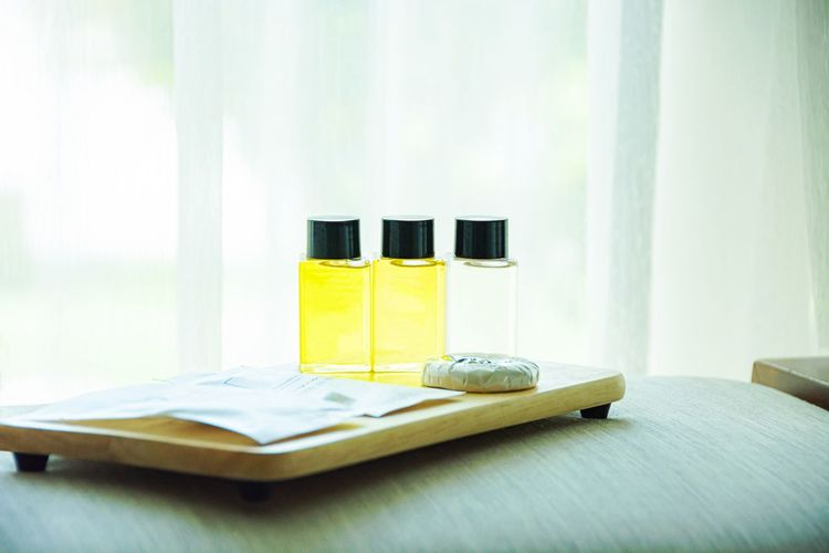 Close-up of bottles with tray on table