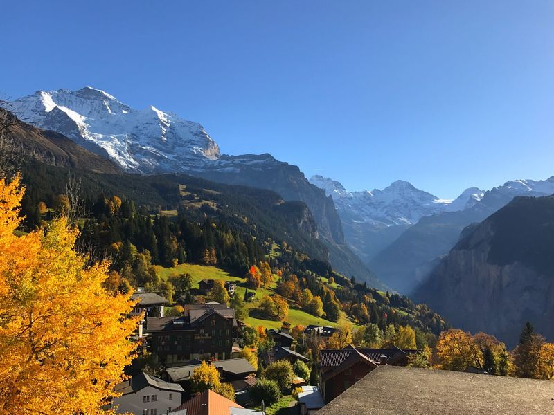 Connected By Travel Mountain Scenics Nature Mountain Range Autumn Beauty In Nature Tranquil Scene Clear Sky High Angle View Outdoors Day No People Tranquility Architecture Sky Yellow Building Exterior Wengen Wengen Switzerland Switzerland Switzerlandpictures Switzerlandwonderland