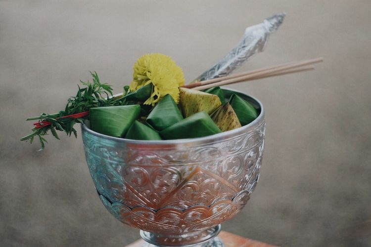 Close-up of leaves in container on table