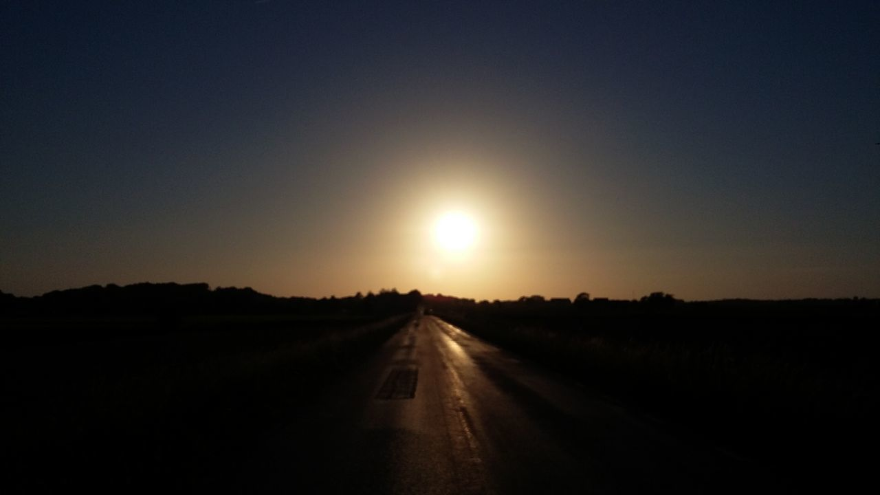 sunset, the way forward, nature, road, no people, scenics, tranquil scene, silhouette, sky, sun, transportation, landscape, outdoors, clear sky, tranquility, beauty in nature, day