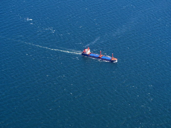 Cargo ship carrying goods aerial view
