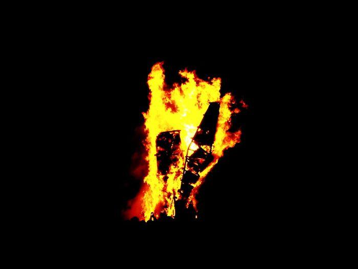Bonfire on fire against black background
