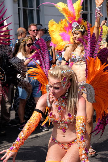 Two Dancers, London School of Samba Composition Dancing Feathers GB London Sunlight Arms Raised Arts Culture And Entertainment Carnival Carnival Costumes Full Frame Fun Headress Incidental People Leisure Activity London School Of Samba Multi Coloured Nottinghill Carnival 2017 Outdoor Photography Performance Smiling Face Two Dancers Two Women Uk Young Women