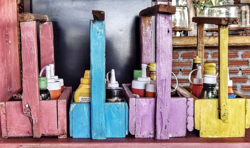 Close-up of condiments in wooden container on table