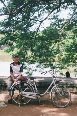 Cambodia Day Full Length Nature One Person Outdoors People Real People Sitting Sky Transportation Tree Wheelchair