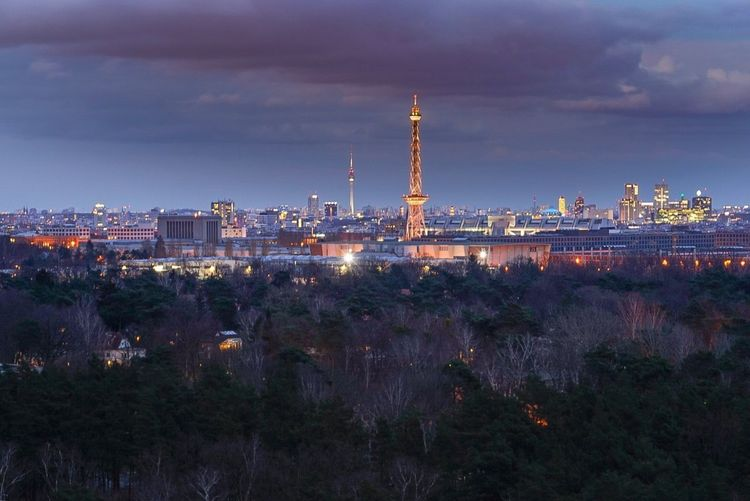 Illuminated city against sky at night