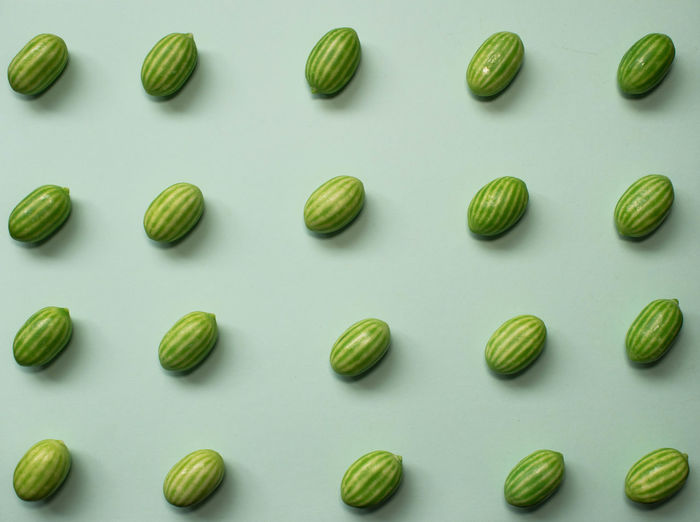 Directly above shot of candies on white background