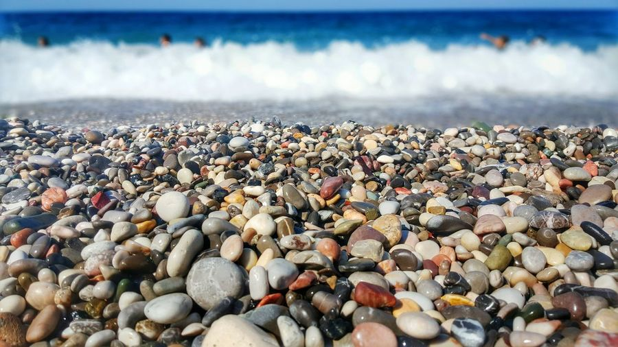 Colorful pebbles at shore on beach