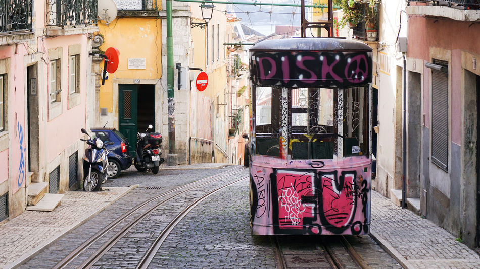 a tram as a disco in Lisbon, Portugal Architecture Colourful Disco Land Vehicle Lisbon No People Old Town The Way Forward Tracks Tram Transportation Travel Yellow