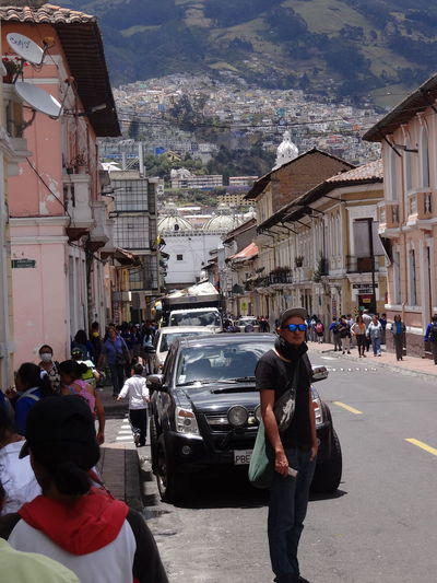 Quito Quito Quito City QuitoEcuador Travel Architecture Backpacker Building Building Exterior Built Structure Car City City Life Cityscape Crowd Ecuador Group Of People Land Vehicle Lifestyles Men Mode Of Transportation Motor Vehicle Outdoors People Real People Rear View Road Solo Traveler Solo Traveller Street Transportation Travel Destinations Traveler Traveller