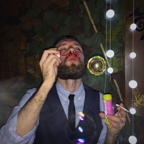 Man Blowing Bubbles In Party