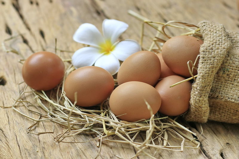 Eggs are placed on an old wooden floor and put on a black plate. Basket Brown Close-up Container Egg Food Food And Drink Fragility Freshness Healthy Eating Indoors  Nature No People Plant Raw Food Selective Focus Still Life Vulnerability  Wellbeing Wood - Material