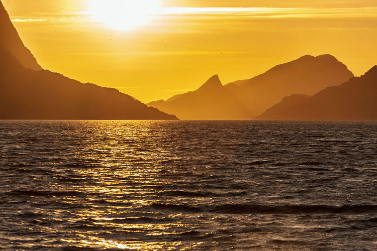 Seascape view at a mountainous archipelago at sunset