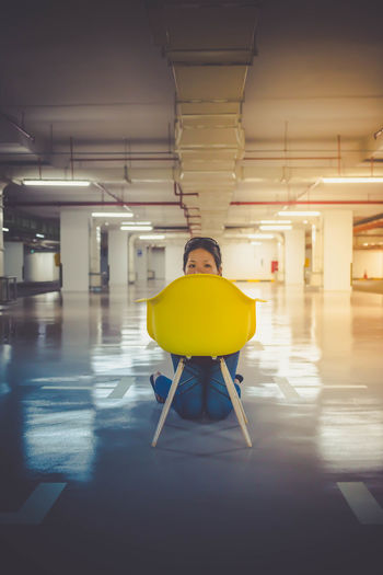 Items required for random fun - Yellow Chair - Empty Carpark - Camera Empty Carpark Illuminated Indoors  One Person Parking Garage Peekaboo People Real People Underground Car Park Woman Yellow Yellow Chair #urbanana: The Urban Playground International Women's Day 2019
