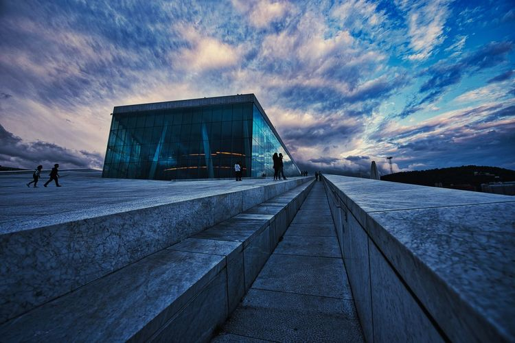 New edit of the Oslo Opera House. Cityscape Opera House Clouds EyeEm Best Shots Sky Cloud - Sky Architecture Built Structure Nature Transportation Water Incidental People City Building Exterior Street Men Lifestyles Outdoors