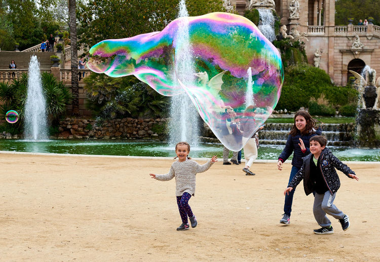 Children catching the soap bubbles in the in the Ciutadella Park in Barcelona. Ciutadella park is one of the finest parks in Barcelona. Park dotted with historic landmarks, statues and fountains Active Barcelona, Spain Catalonia Childhood Children City Ciutadella Park Crowd Of People Day Entertainment Europe Famous Place Fun Human Landmark Motion People Show Soap Bubbles SPAIN Spring Tourist Tourist Attraction  Travel Destinations Youth