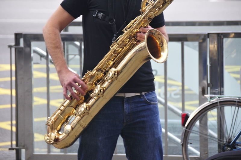 Saxophone Street Musician Musical Instrument One Person Music Midsection Saxophone Artist Real People Playing Holding Musician Focus On Foreground Saxophonist Arts Culture And Entertainment Men Casual Clothing Skill  Standing Indoors  Occupation Entertainment Occupation Jeans Street Musician The Art Of Street Photography