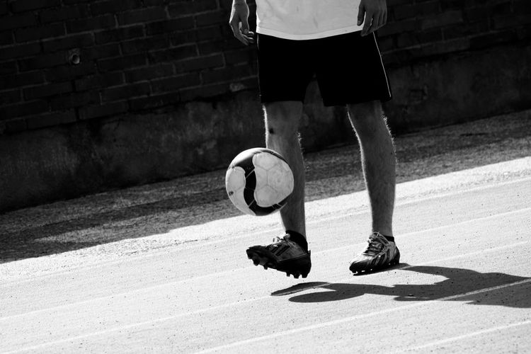 Low section of man playing with ball