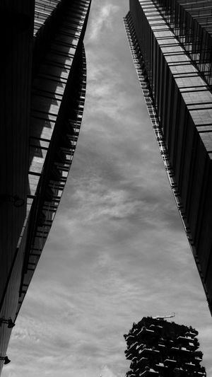 Looking up between skyscrapers in Porta Nuova Business District, Milan. Porta Nuova Business District Skyscrapers Sky Low Angle View Cloud - Sky Building Exterior Architecture No People Streetphotography Perspective City Milano Skyscrapers Architecture Black And White Photography Building Cityscape Lookingup Low Angle View Minimalist Architecture Monochrome High Rise EyeEmNewHere Looking Up Tall - High