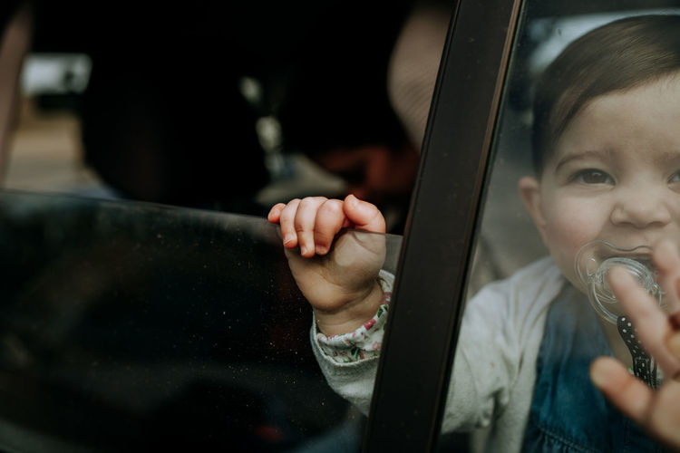 Farewell Baby Babyhood Childhood Children Togetherness Toddler  Focus On Foreground Child Real People Innocence Cute Glass - Material People Leisure Activity Portrait Holding Lifestyles Positive Emotion Care Car Window Vehicle Interior Travel Trip Young Indoors  Family Matters Family With One Child Hand My Best Photo