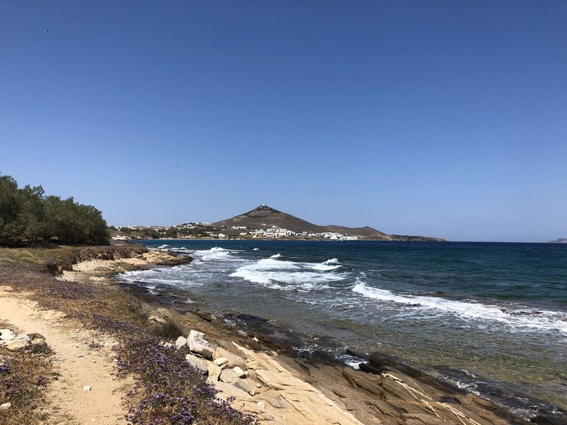 Beautiful beach view, Paros, Greece Paros Beach Beauty In Nature Blue Clear Sky Copy Space Greece Land Motion Mountain Nature No People Outdoors Powerful Waves Rock Scenics - Nature Sea Sky Summer Destination Tourist Destination Tranquil Scene Tranquility Travel Water Wave