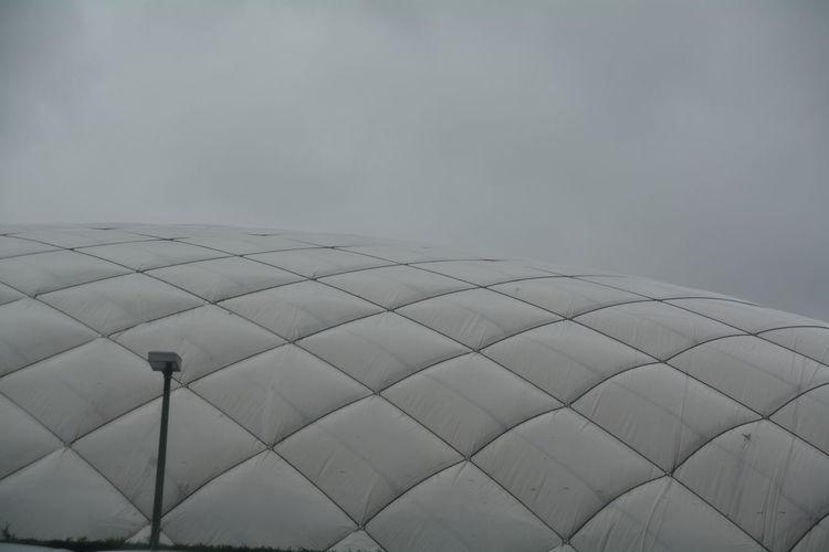 Stadium roof against cloudy sky at dusk