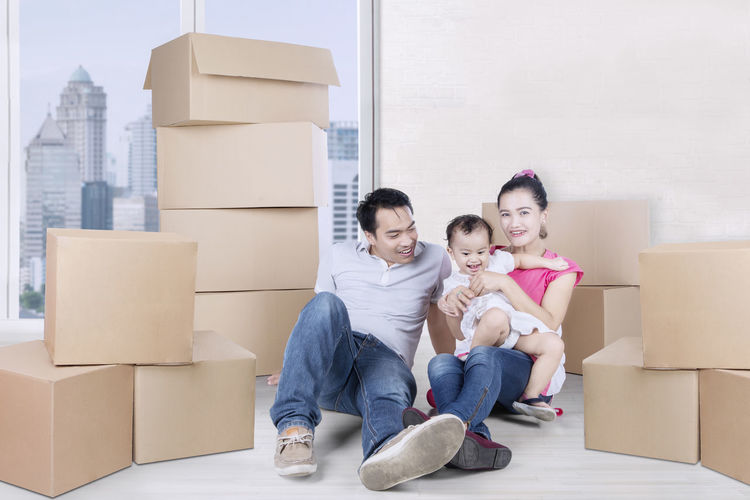 Box Box - Container Cardboard Cardboard Box Casual Clothing Childhood Container Emotion Females Front View Full Length Happiness Home Ownership Looking At Camera Moving House Outdoors Packing Portrait Positive Emotion Sitting Smiling Togetherness Women