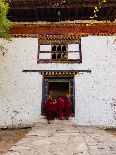 Monks going out through a door. Bhutan Monks Buddhism Bhuddist Temple Temples Travel Destinations Bhutan