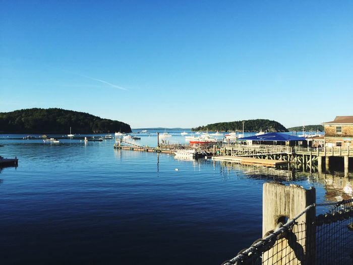 Water Sea Blue Clear Sky Pier Harbor Mountain Waterfront Day Calm Tranquil Scene Copy Space Transportation Boats at Bar Harbor , Maine Bar Harbor, Maine