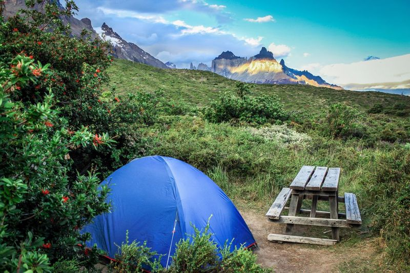 Mountain Nature Landscape Mountain Range Outdoors Grass Sky Adventure No People Wilderness Snowcapped Mountain Trekking Camping Nature Shelter Tranquility Tent Patagonia Torres Del Paine