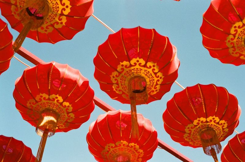 Low Angle View Of Lanterns Hanging Against Sky