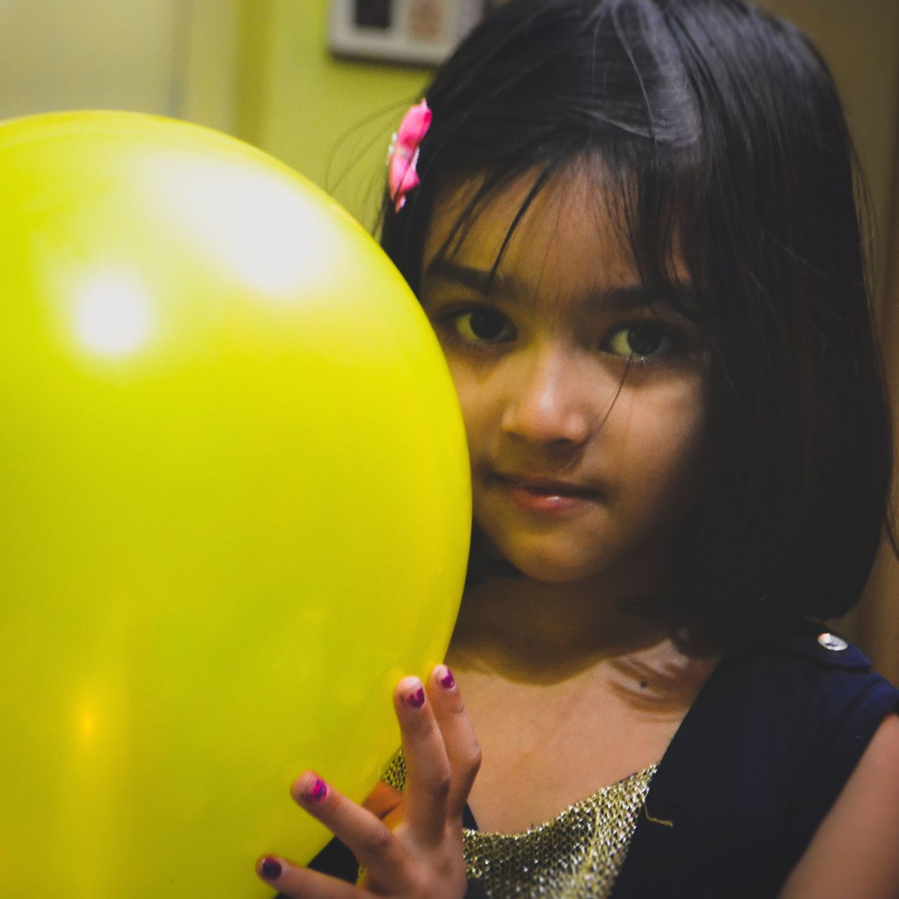 real people, one person, balloon, childhood, headshot, elementary age, leisure activity, focus on foreground, holding, girls, close-up, lifestyles, indoors, day, young adult