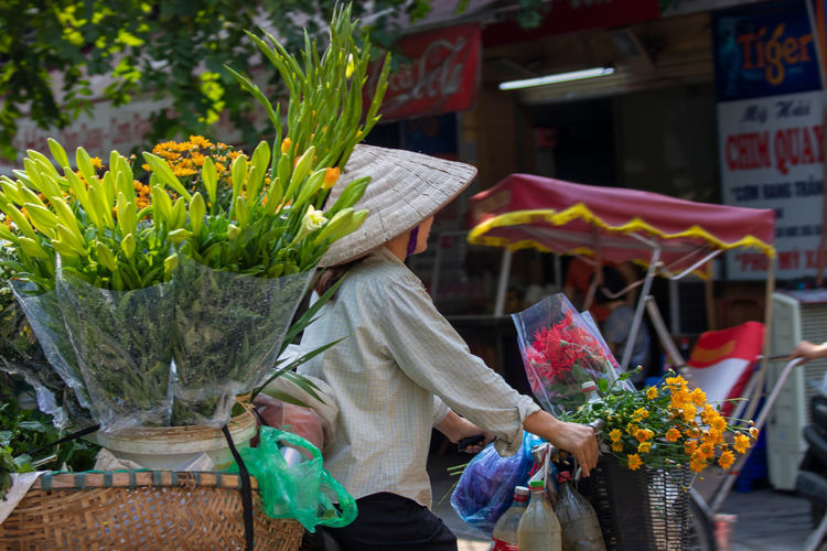 Woman with flowers for sale in market