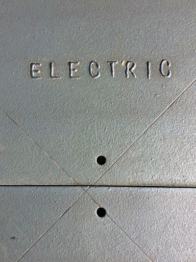 Metal Electric Power Supply Street Cover Close-up No People Solid Metal Sign Technology EyeEm Best Shots I Pad Mini Ipadphotography Sunny Winter Sun Typography Concrete Floor Street Typography Sunlight lines and holes Day Text Outdoors Dec 2016 Looking Down Grey Concrete Texture Lines Scored In Plate