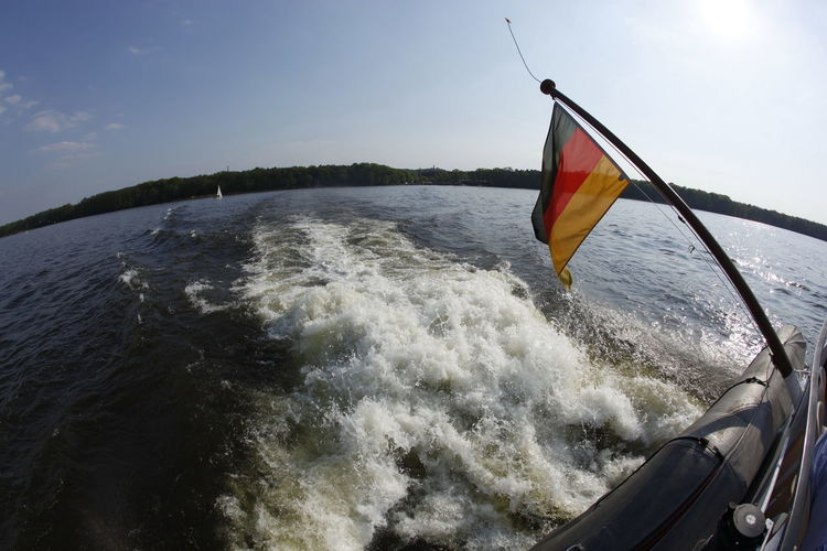 Backwash Beauty In Nature Boat Day Deutschland Flag Flagge Lake View Motion Müggelsee Nature No People Outdoors Patriotism Schwarz Rot Gold Sea Sky Wake Water