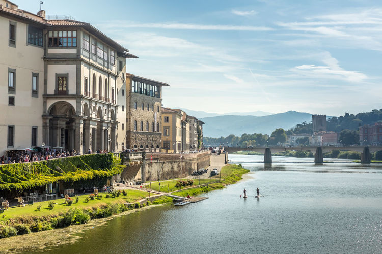 Florence and the river Arno Italy Arno River Arno  Florence, Italy Florence My Best Travel Photo Architecture Building Exterior Built Structure Water Sky City Nature Building Cloud - Sky Day Incidental People Travel Destinations Plant Outdoors Tree Sunlight Residential District River