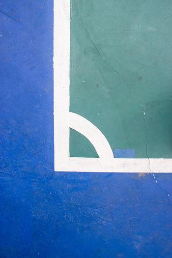 Close-Up Of Graffiti On Blue Wall