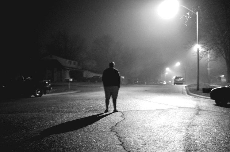 Blackandwhitephotography Fog Foggy Night Forlorn Full Length Illuminated Man Night Real People Rear View Road Standing Street Street Light The Way Forward Walking Visual Creativity