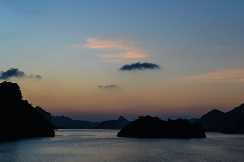 Halong Bay Vietnam Beauty In Nature Cloud - Sky Idyllic Nature No People Orange Color Outdoors Rock Rock - Object Scenics - Nature Sea Silhouette Sky Solid Sunset Tranquil Scene Tranquility Water Waterfront