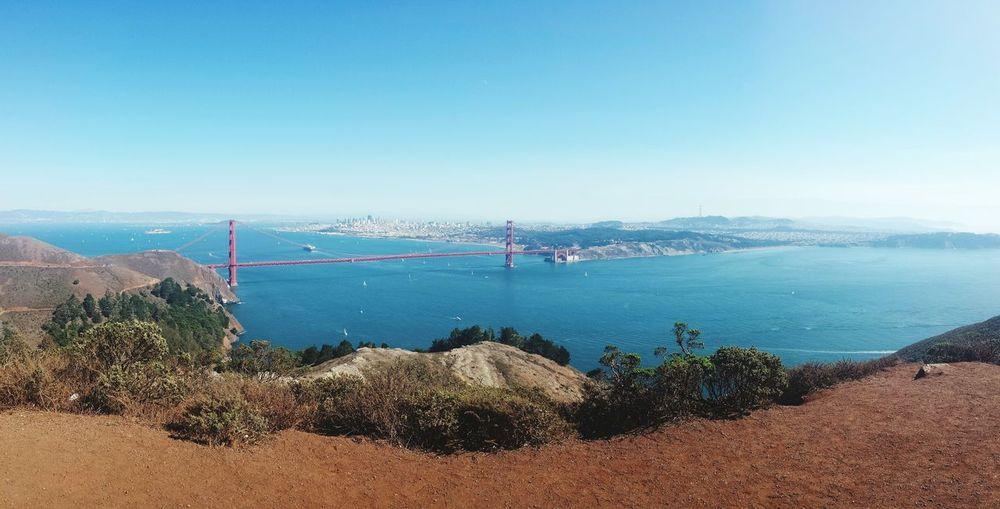Scenic view of golden gate bridge over bay against sky