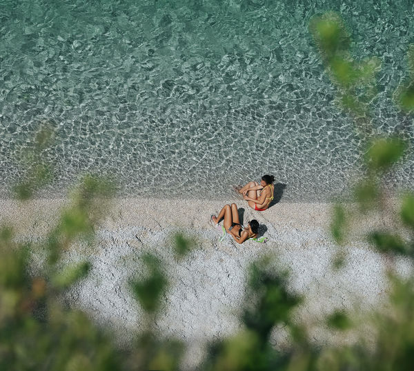 Green Summer High Angle View Water Nature Sea Beach People Two People Women Focus On Background Plants Leaves Full Length Close-up Tiny Pebble Beach Shore Wave The Art Of Street Photography