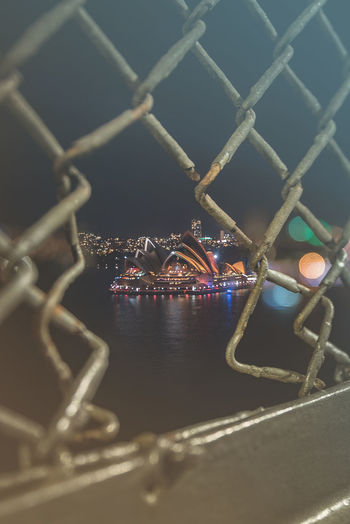 Close-up of illuminated chainlink fence