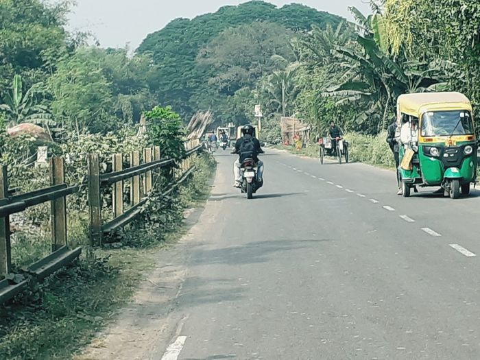 Man cycling on road in city