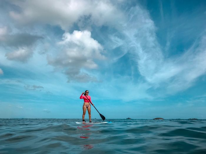 Paddleboarding Caribbean Ocean Beach Water Sport Sea Water Sky Cloud - Sky Beauty In Nature Beach Full Length Nature Scenics - Nature Outdoors Sport Lifestyles Tranquility Standing My Best Photo The Mobile Photographer - 2019 EyeEm Awards
